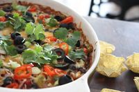 Baked Black Bean Fiesta Dip with bubbly cheese and fresh cilantro. I want to eat this right nooow!!