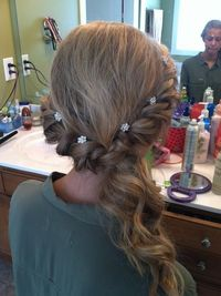 Simple but elegant twist and pull to the side with curls for prom. I might just do this for my prom!