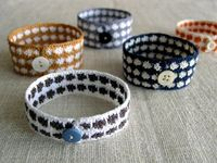 The breathtaking pieces of the extremely talented and generous artist, Laura Normandin, include paper goods, granny square art, jewelry, handmade dolls, and these wonderfully charming crocheted bracelets that she has kindly agreed to teach us to make. Inf...