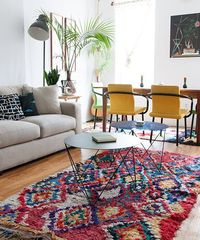 his is our living/dining room. I got a new couch recently and it's been a real game changer. You can fit 6 people on it very comfortably. We have had a lot of TV parties! I got the boucherouite rug in the dining room on Etsy and the chairs were desi...