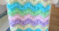 A lovely crochet baby blanket with frilly by AuntieJenniesAttic