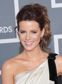 How to Get Kate Beckinsale's Curly Chic Ponytail from BeautyRiot: Mist roots of day-old hair with dry shampoo, then spray each section with light-hold hairspray & wrap around a 1.5 in. curling iron, leaving the ends out. Then tease lightly at crow...