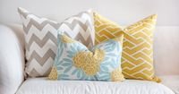Caitlin Wilson Textiles - Mustard Fleur Chinoise pillow, Mustard City Maze pillow, and Greige Zabeel Chevron pillow