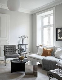 I think the color palette of this home works very well. The walls have all been painted in a greige (grey and beige mixture) but the ceilings are kept white and