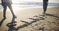 Maternity photo idea... with little one's name written in sand at the beach