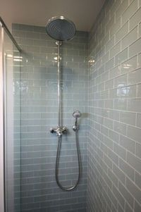 LOVE: blueish gray subway tile in shower - very spalike plus waterfall shower head with detachable sprayer mounted low on wall