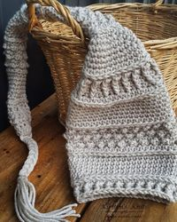 "A crochet pattern that is a slightly different take on the classic newborn elf hat, and would work for boys as well as girls. Requires ""I Love This Yarn"", or yarn with similar softness, and drape."