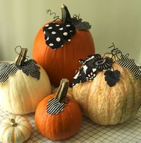 decorated pumpkins using fabric and/or scrapbook paper