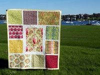 """""""Parisville fat quarter bundle made into a """"Loulouthi Tiles"""" baby quilt. Easy and effective way to show off favourite large patterned fabrics."""