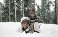 Young boy and dog at the Hämeenlinna war dog school in Finland during WWII.