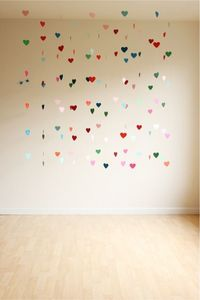 construction paper, paper hearts and backdrops.