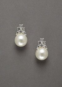 An update to the classic pearl, perfect for the bride who loves both pearls and crystal in a classic form! Beautiful pearl stud earrings with crystal cluster accent. Imported. Available in Silver.