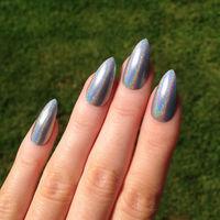 Ultra Holographic Silver Stiletto nails