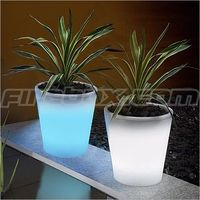 Glowing Flower Pots. Paint flower pots with Rustoleums Glow in the Dark paint. Absorbs sunlight by day glows at night.