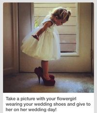 Wedding - Flower girl wearing the bride's shoes to give to her on her wedding day.