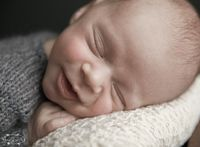 This baby boy had the cutest one-sided smile! I loved his Denver newborn photography session.