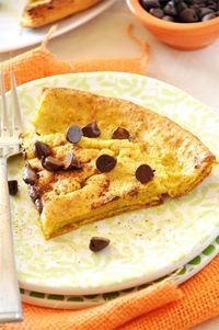 A light and delicate dutch baby with a hint of pumpkin flavor and plenty of gooey chocolate chips on top.