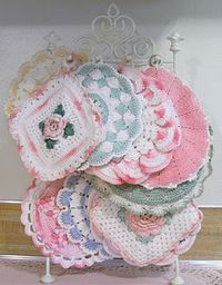 Two hand crochet potholders presented with a small matching color casserole dish. Yep! Another Southern thing.