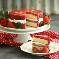 Strawberry Cream Dream Cake Recipe: flour, baking powder, salt, eggs, sugar, vanilla, lemon flavoring, lemon zest, cream of tartar, strawberries, unflavored gelatin, red food coloring and heavy whipped cream.