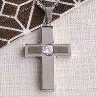 Great for dress-up occasions but simple enough to wear every day, this Personalized Jewel Inlay Cross Pendant is a lovely addition to any outfit. Made of no-tarnish stainless steel and featuring a 58 faceted Cubic Zirconia, it's for any special occa...