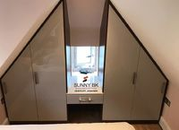 Angled wardrobes by Sunny Bedrooms and Kitchens Limited in Luton.jpg