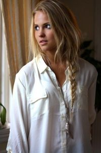 love the simplicity, white shirt, braided hair...