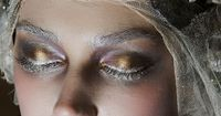 Metallic gold and silver eyeshadow and lashes.