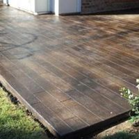 scored and stained concrete to look like wood floors on the patio