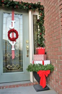 "Unique and fun Front Porch Decor- Joy ""wreath"" and Present Topiary."