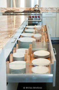 Instead of storing plates in upper cabinets, this kitchen from Divine Kitchens uses plate drawers with adjustable dividers. Where would you prefer to store your plates, in upper cabinets or drawers like these?