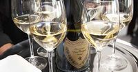 Waiters passed trays of Dom Perignon champagne as guests entered the reception area.