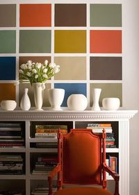 Tape off squares on a basic white wall and then paint them in with different colors to create a feature piece!