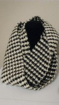 Learn how to crochet a scarf that is the essence of style. It's hard to find patterns that make anything as cute as this Houndstooth Crocheted Scarf. Share your