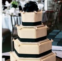 Andrea and Craig's four-tiered hexagon-shaped cake was covered with pearl-beaded frosting and black ribbon. The inside was just as delectable -- it was white cake with raspberry filling and chocolate cake with Baileys filling.