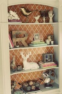 Great idea to add a little color to shelving or bookcase. Put foam board with wallpaper or staple wrapping paper on back of bookshelf... change out when you get bored.