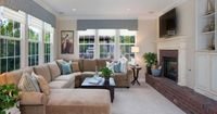 Great layout for the living room, windows are in the same place, depth is similar. Sectional sofa & narrow room.