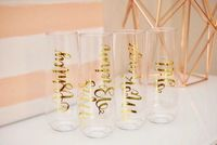 Custom plastic stemware at $6.75 each with founders' names - not keepsakes, but fun for day-of