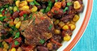Food Advertising by A one-dish meal featuring meatballs with spicy corn, tomatoes and black beans. To me, this recipe is all about the seasonings with chipotle
