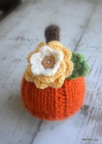 Pumpkin Hat, Knit Baby Cap Knitted Newborn Infant Fall Photo Prop, Halloween, Removable Sweet Fall Flower. $24.99, via Etsy.