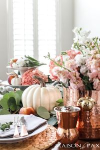 Fall tablescape with pumpkins and peaches: Blush tones and copper accents make it a non-traditional but stylish option for your fall or Thanksgiving table.