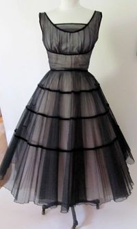 Vintage 1950's black and pink tulle dress. I'm pinning this for the shape (though I'd like it shorter). Clearly Christina is right: there's something about 1950s Mad Men style that just makes me happy.