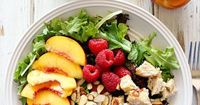 This Peach & Raspberry Chicken Salad is a simple Summer salad with a lot of flavor! The homemade Peach Vinaigrette sends it over the top! You can keep the kitch