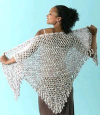 This crochet shawl for summer is great to wear over a dress on a chilly summer night. Try this free crochet pattern to make a pretty shawl with fringe for all o