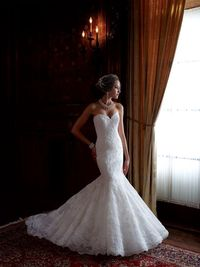 Strapless lace, English net and organza mermaid wedding dress with sweetheart neckline, corded lace slimming bodice with softly curved back bodice, dramatic dropped waistline, fit and flare skirt with matching lace appliqué on English net over organza wi...