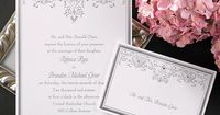 Hearts And Vines - Invitation from Carlson Craft - Item Number: WR9742 - A bright white invitation card features a rich silver border with silver heart and filigree design at the top with gold accents. #CarlsonCraft #weddinginvitation