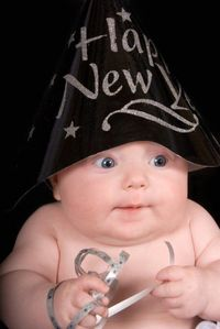 Baby New Year, looks excited about the New Year coming in.