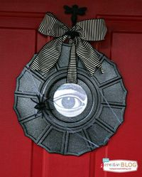 Make this Ceiling Medallion Halloween Wreath in less than one hour with spray paint! Trick out your door with a simple, yet unique wreath!