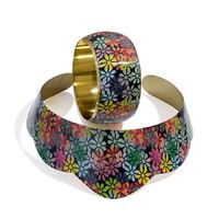 Fabulous collar necklace and bracelet with floral motifs in multi colours  A perfect pair for your party outfits and many other styles  The multi-coloured necklace is covered with floral motifs that make up its metallic appearance . The floral design ...