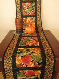 Use up some of that Autumn fabric I've got in the closet. autumn leaves table runner