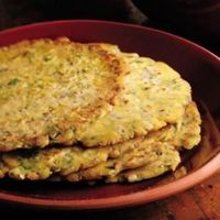 Griddle-Cooked Corn Flatbread (Makkai ki roti) This flatbread (classically not flavored) from Punjab, deemed peasant food, often accompanies a puree of mustard greens and garlic drizzled with ghee (clarified butter). This version i...